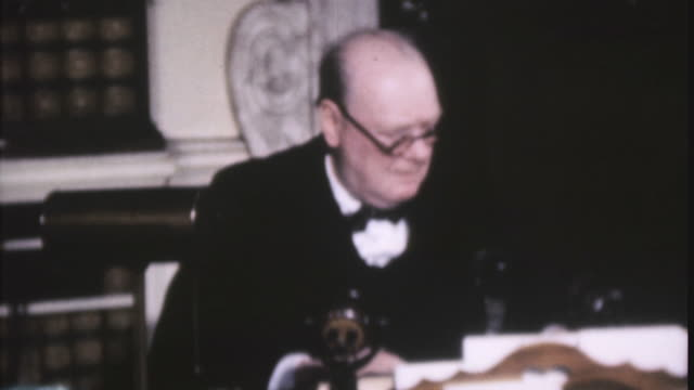 ha british prime minister winston churchill sitting at desk reading documents speaking and wiping eyes with handkerchief during world war ii - winston churchill stock videos & royalty-free footage