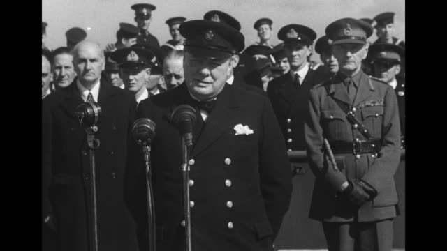 british prime minister winston churchill speaking into microphones military leaders and sailors standing behind him as he speaks from deck of the hms... - winston churchill prime minister stock videos and b-roll footage