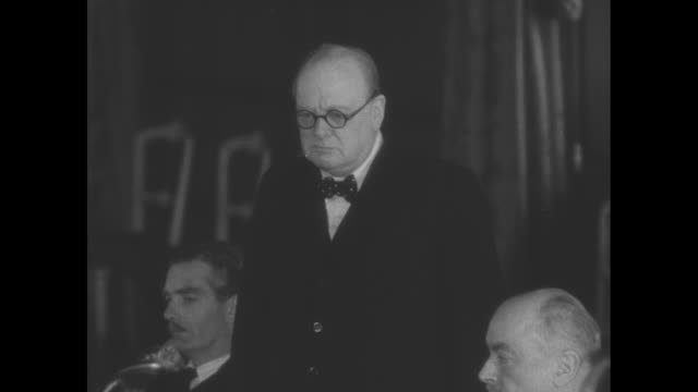 british prime minister winston churchill speaks at conference of commonwealth and allied foreign ministers anthony eden and clement attlee sit at his... - speech stock videos & royalty-free footage