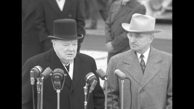 British Prime Minister Winston Churchill speaks at microphones US President Harry S Truman stands next to him It's always a great joy to me to come...