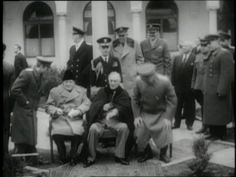 british prime minister winston churchill, united states president franklin d. roosevelt, and soviet premier joseph stalin attend the yalta conference. - guerra fredda video stock e b–roll