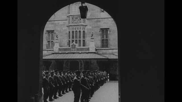 VS British Prime Minister Winston Churchill with officers reviewing troops standing in formation / SOT Churchill speaks to troops / tiltup shot Big...