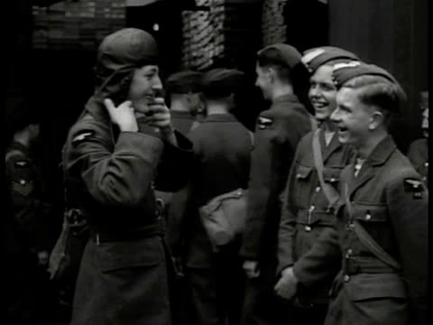 british r.a.f. pilots in uniform turning in formation. pilot putting on headgear talking. large group of pilots in uniform marching in formation... - britisches militär stock-videos und b-roll-filmmaterial
