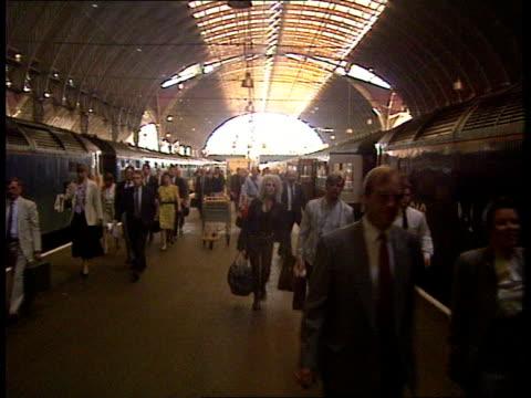 paddington: passengers off train as voice on tannoy apologises for delay: passengers buying tickets: intvw maj gen lennox napier : - british rail stock videos & royalty-free footage