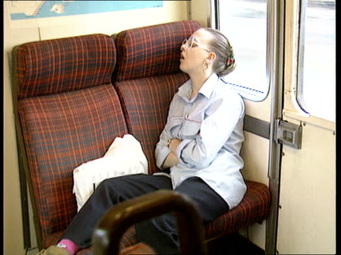 vídeos de stock e filmes b-roll de transport british rail losses int train lms lone passenger seated in carriage ms young woman asleep slumped across seat camera on car ls inter city... - british rail