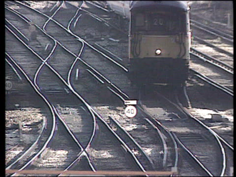 vídeos de stock e filmes b-roll de british rail privatisation house of lords disrupts process ext tgv trains along on tracks tms ditto gv trains going through stations ms front of... - british rail