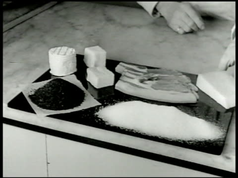 british rationed items bacon, butter, coffee, sugar, cheese. female hand cutting ration book. more rationed foods: box of quaker malted corn flakes,... - world war ii stock videos & royalty-free footage