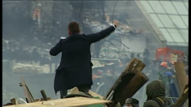 British relationship with Europe cools as former Soviet republics move closer 1922014 / T19021402 DAY Protester making speech from atop barricade...