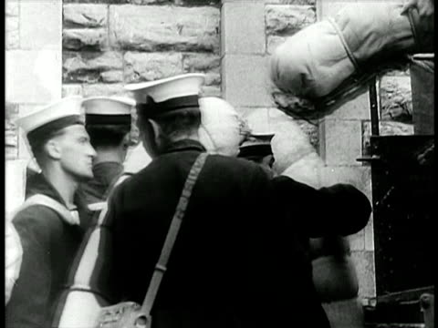 vídeos de stock, filmes e b-roll de british sailors packing bags into back of truck / israel / documentary - 1948