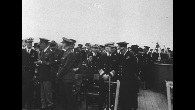 stockvideo's en b-roll-footage met british sailors pass stacks of small boxes to each other on down a line / 8/9/41 qs british pm winston churchill and us president franklin roosevelt... - geallieerde mogendheden