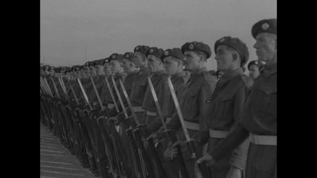 british sailors standing at attention with fixed bayonets / admiral and civilian chat / line of us marines at attention / british soldiers in berets... - paper scroll stock videos and b-roll footage