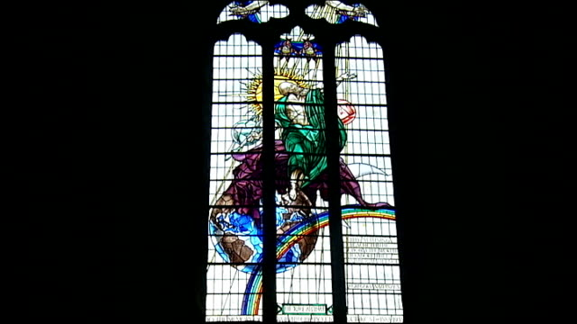 british scientists hunt for dark matter in a yorkshire mine durham cathedral stained glass window - イングランド ダラム点の映像素材/bロール