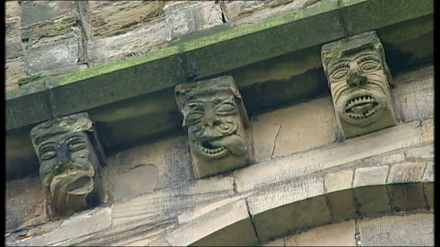 british scientists hunt for dark matter in a yorkshire mine ext durham cathedral sot gargoyles on cathedral building various of durham cathedral - イングランド ダラム点の映像素材/bロール