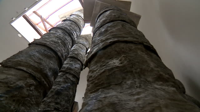 british sculptor phyllida barlows latest creation comprising of several pillars is displayed in a gallery leading up to the venice biennale art event - textured effect stock videos & royalty-free footage