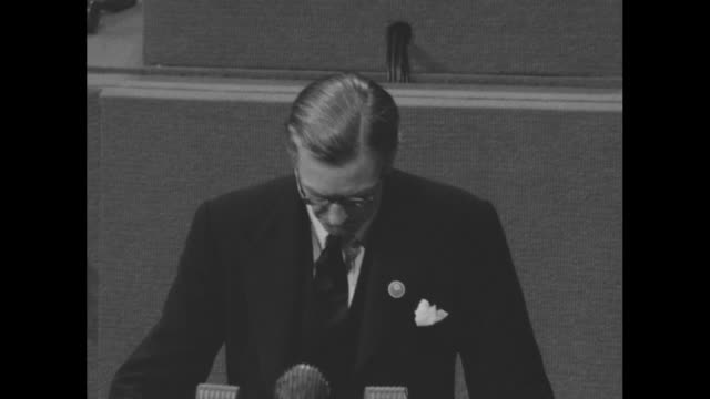 British Secretary of State for Foreign Affairs Sir Anthony Eden addresses first plenary session of the United Nations wearing eyeglasses as he reads...