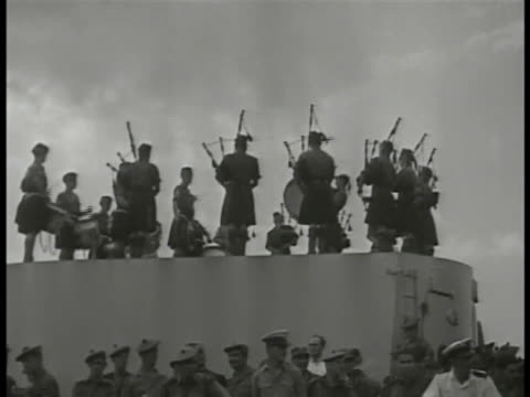 british ship in harbor scottish pipe drums playing on deck soldiers laughing south korean children waving flags filipino soldiers arriving from... - korean war stock videos & royalty-free footage