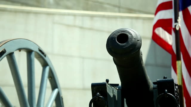 british six-pounder cannon and american flag - 18th century style stock videos and b-roll footage