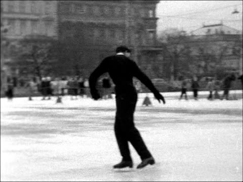 vídeos de stock, filmes e b-roll de british skaters in vienna austria vienna ext michael booker practising / ms patricia pauley mactising comes to cu / ms patricia skating doing... - pirouette
