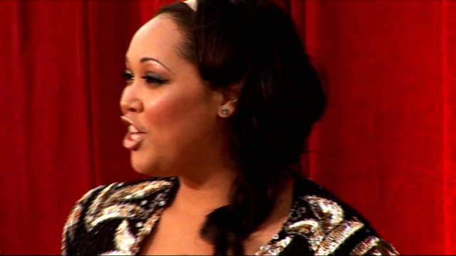 british soap awards 2010: red carpet arrivals and interviews; diane keen posing on red carpet / unidentified couple posing / donnaleigh bailey posing... - ソープオペラ点の映像素材/bロール