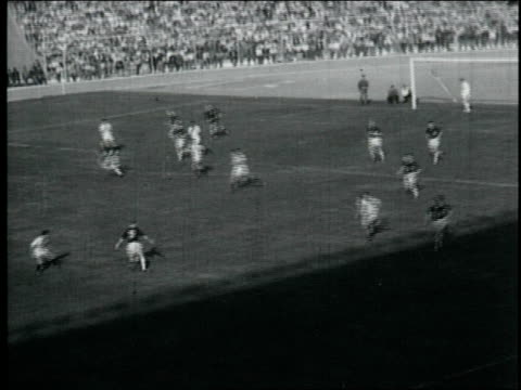 british soccer team plays against peru / cheering fans in stadium / peru wins, fans run onto field peru wins soccer game against britain at estadio... - anno 1959 video stock e b–roll