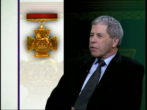 british soldier awarded the victoria cross for bravery england london gir int cms max arthur interview sot such a rare award london cs victoria cross... - the victoria cross stock-videos und b-roll-filmmaterial