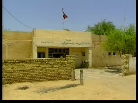 british soldier killed in basra bomb attack lib gv police station where british military police were killed bullet holes on wall - basra stock videos and b-roll footage
