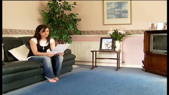 british soldier killed: last letter to girlfriend; england: hampshire: aldershot: int jane little sitting on sofa with letter jane little interview... - aldershot stock videos & royalty-free footage