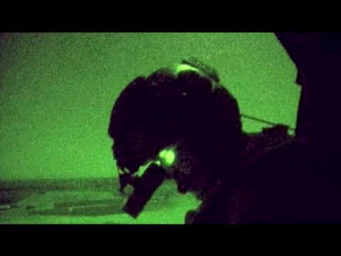 british soldier travels through desert at night 10 september 2009 - 2001年~ アフガニスタン紛争点の映像素材/bロール
