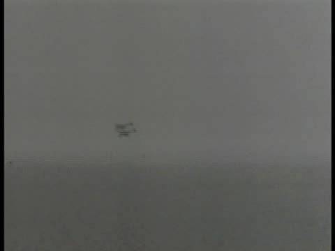 British soldiers firing antiaircraft cannon XWS Fighter airplane crashing into sea Soldiers firing antiaircraft gun XWS Smoke trails from falling...