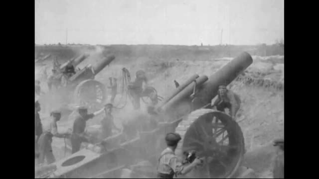 british soldiers firing on the german front lines / soldiers firing huge guns / soldiers on battlefield - battlefield stock videos & royalty-free footage