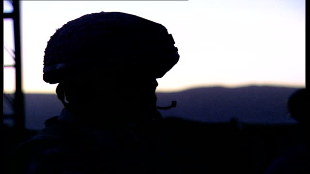 british soldiers in helmand province good shots of soldiers behind sandbag walls on rooftop silhouetted shots of british soldiers keeping watch day... - sandbag stock videos & royalty-free footage