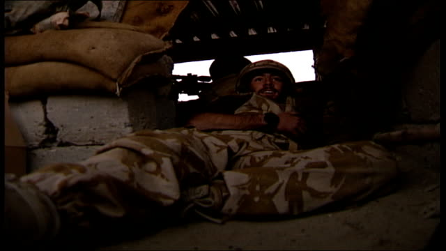 british soldiers in helmand province low angle view of soldier lying inside camouflage watchtower as soldiers outside prepare to fire missile and... - sandbag stock videos & royalty-free footage