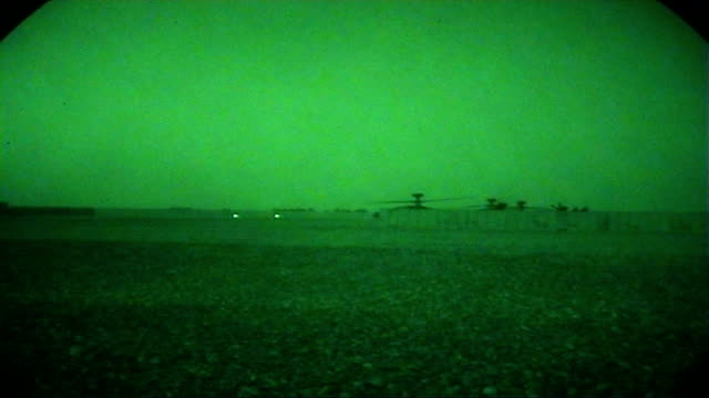 british soldiers in helmand province night soldiers sitting in the back of chinook helicopter good shots of apache helicopters taking off seen from... - night vision stock videos and b-roll footage