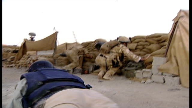 british soldiers in helmand province side view soldier standing behind sandbag wall back views soldier in watchtower shaky camera shots of soldiers... - 手ぶれ点の映像素材/bロール