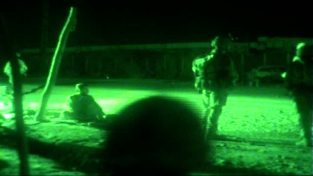 british soldiers in helmand province soldier using field radio/phone various of soldiers through town taking up positions with guns on street corners... - night vision stock videos and b-roll footage