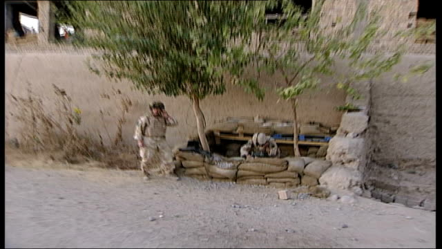 british soldiers in helmand province two soldiers in compound room preparing basic food and water provisions forward as camerman runs through... - sandbag stock videos & royalty-free footage