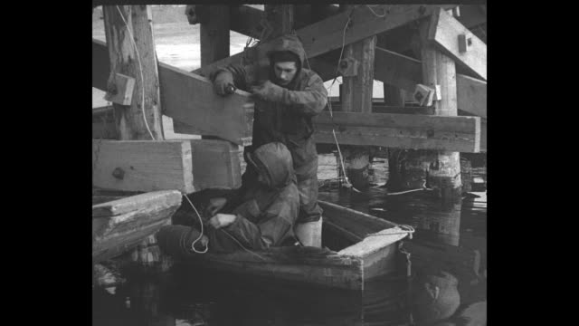 british soldiers in small rowboat work underneath the han river bridge, setting dynamite charges / note: exact day not known - explosive stock videos & royalty-free footage