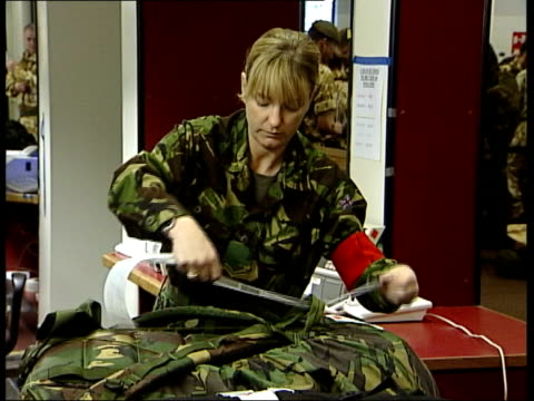 British soldiers leave for mission in Iraq soldier parents interviewed ITN British soldier packing rifle into carrying case as preparing for flight...