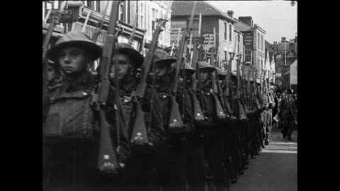 montage british soldiers marching down a city street and children walking down war-torn streets surrounded by rubble / oxford, england, united kingdom - 1946 stock videos & royalty-free footage