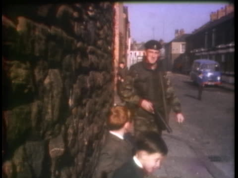 british soldiers patrol a city street in belfast. - (war or terrorism or election or government or illness or news event or speech or politics or politician or conflict or military or extreme weather or business or economy) and not usa stock videos & royalty-free footage
