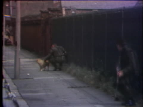 british soldiers patrol a sidewalk during a cease-fire in northern ireland. - outdoors stock videos & royalty-free footage