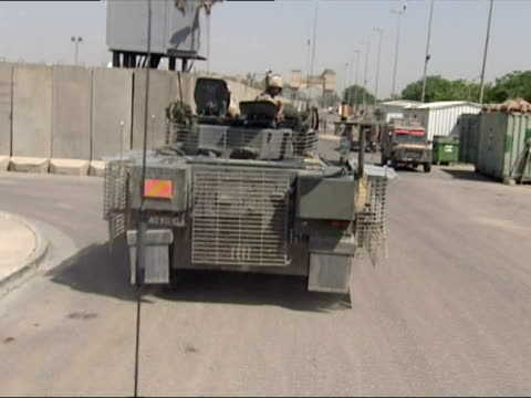 british soldiers patrol the streets of basra - basra video stock e b–roll
