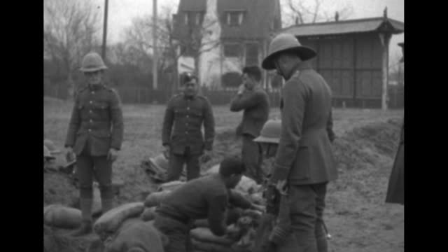 british soldiers putting up barbed wire / two shots of soldiers digging trench / two shots of soldiers building sandbag barricades / two shots of... - sandbag stock videos & royalty-free footage