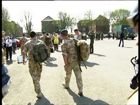 british soldiers return from basra to be greeted by families at raf uxbridge parking lot on may 4, 2007 / uxbridge, london, england/ audio - toothy smile stock videos & royalty-free footage