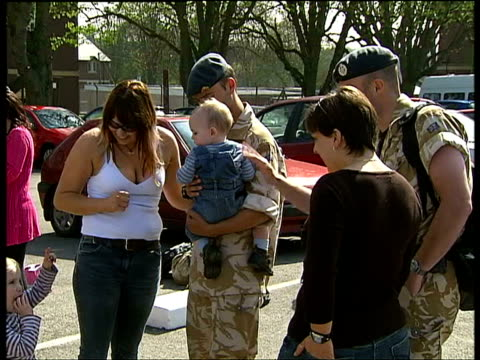 british soldiers return from basra to be greeted by families at raf uxbridge parking lot / soldier and wife playing with young son / soldier and... - toothy smile stock videos & royalty-free footage
