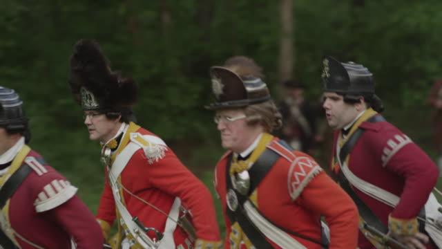 british soldiers running across field during revolutionary war reenactment - revolution stock videos & royalty-free footage