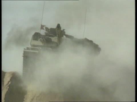 British soldiers under training a SAUDI ARABIA LBV British tanks away through desert and lots of dust BV Column of Challenger tanks along desert CMS...