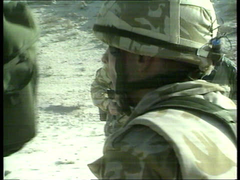 british soldiers under training poor sound saudi arabia ms track back as two soldiers in camouflage and carrying guns dragging 'injured' colleague... - lying on side stock videos & royalty-free footage