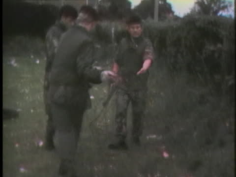 british soldiers unroll barbed wire to separate the catholics and protestants in belfast. - war or terrorism or military stock videos & royalty-free footage