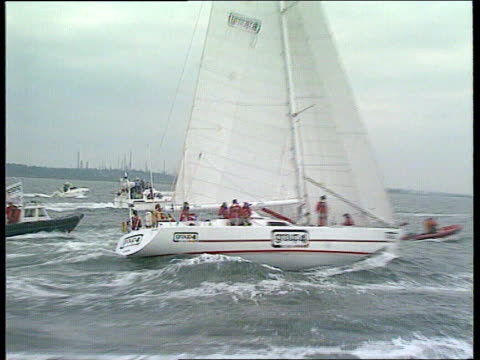 british steel round the world challenge 2315 solentsouthampton ms nuclear electric as along at sea pan rl ms flottilla of small boats welcoming group... - on one leg stock videos & royalty-free footage